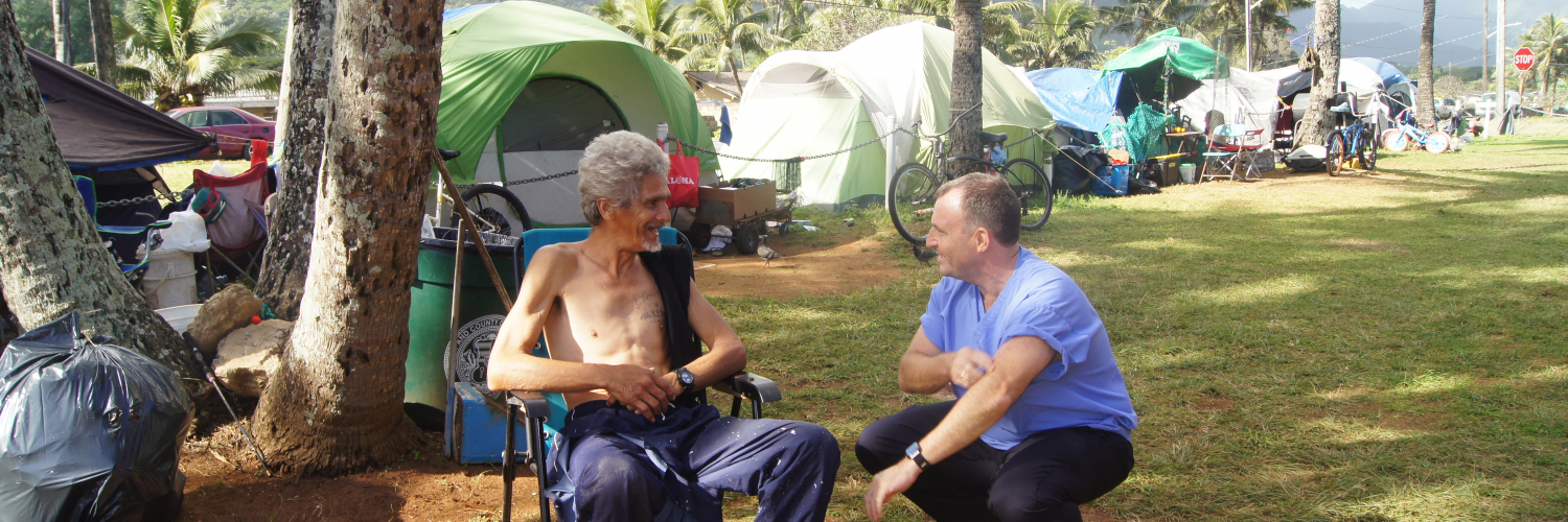 The Lieutenant Governor talks with homeless Waimanalo man
