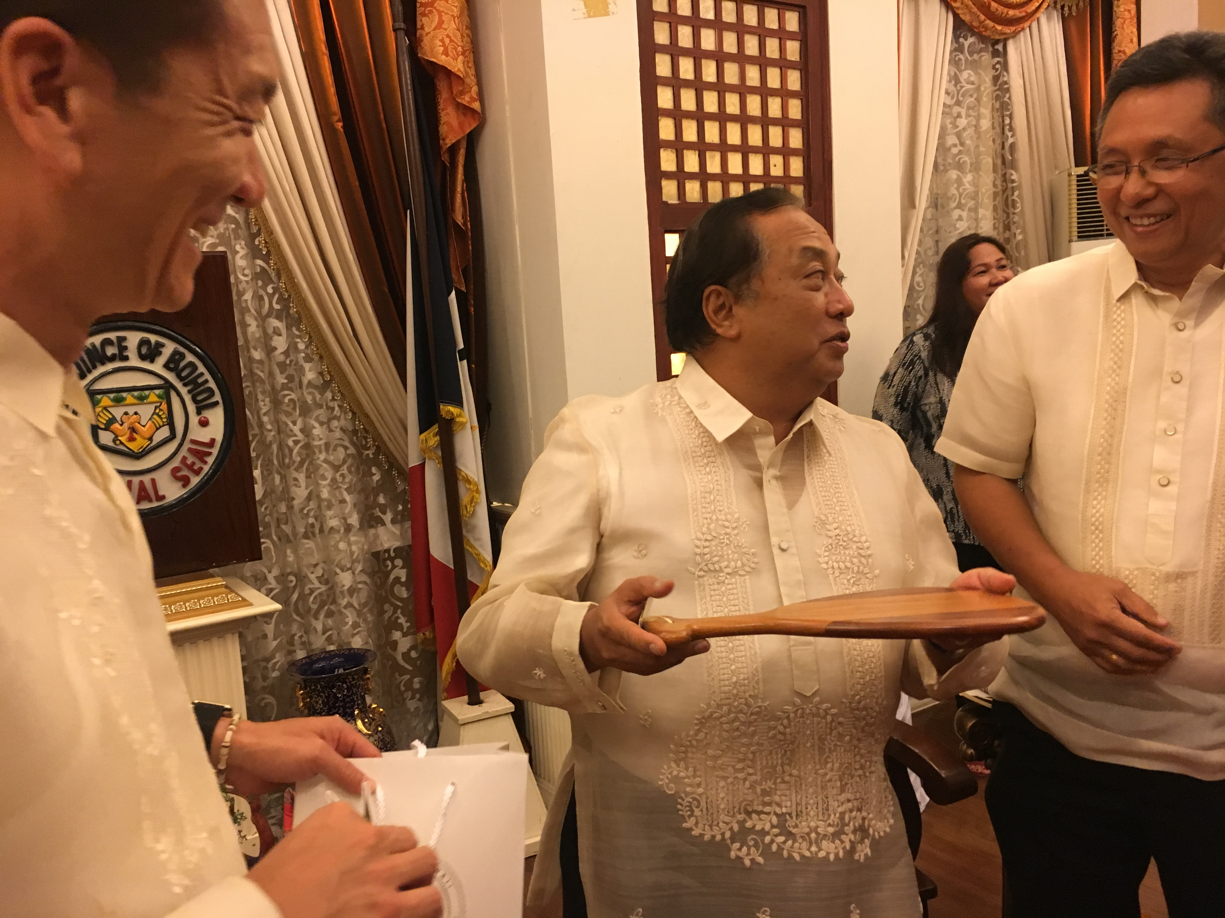 Governor Edgar Chatto shows off his gift