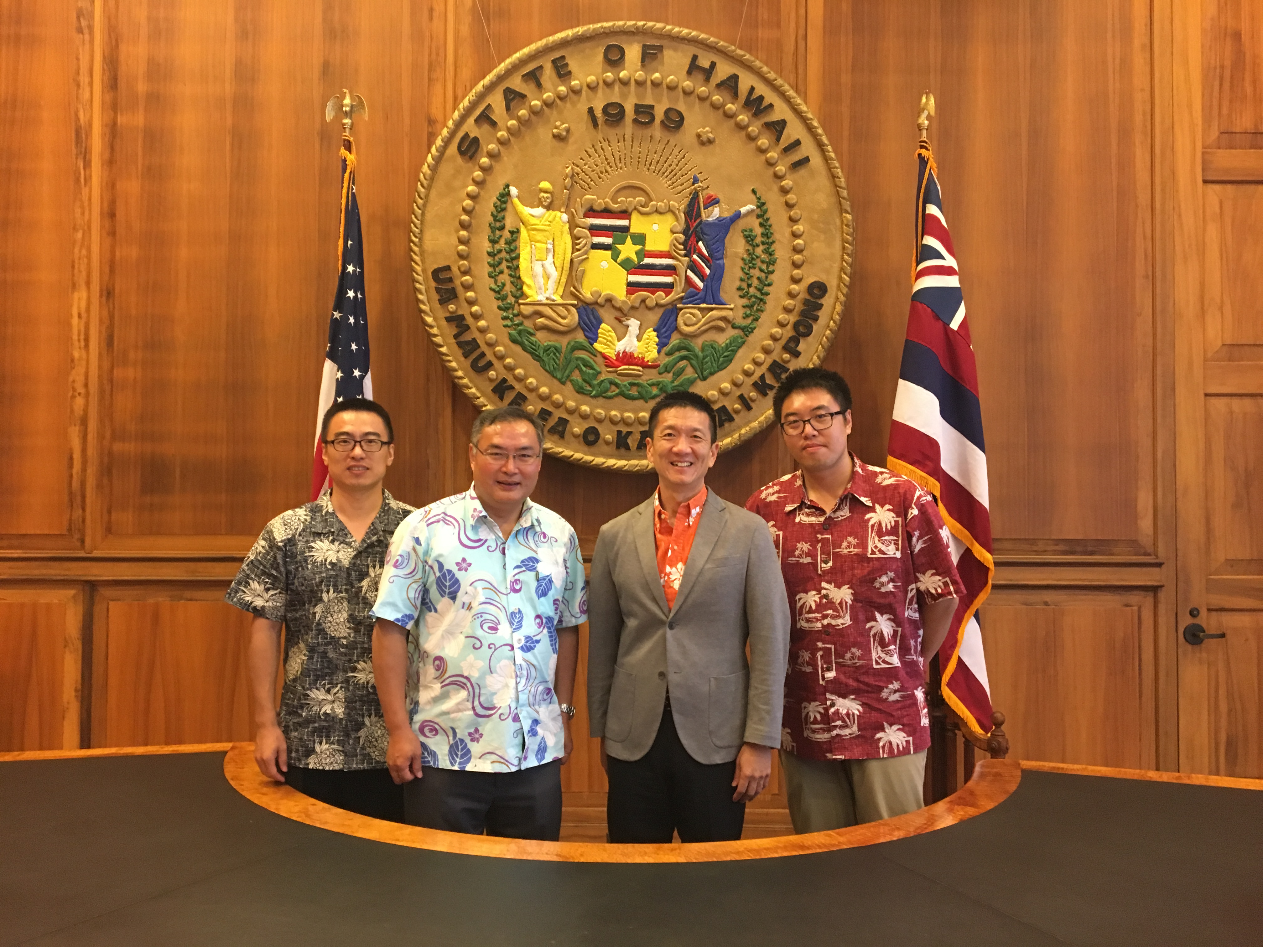 Lt. Gov. Chin in front of state seal with Consul General Zhang and staff